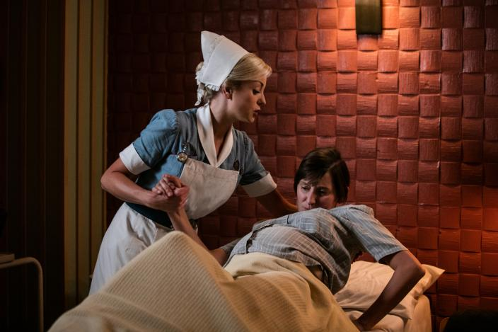 Nurse Franklin (Helen George) assists maternity and dental patient Crystal Williams (Laura Elphinstone)  (Photo: Courtesy of Neal Street Productions 2016)