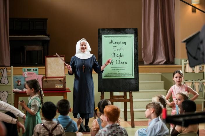 Sister Winifred (Victoria Yeates) teaches dental health.  (Photo: Courtesy of Neal Street Productions 2016)