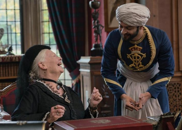 The friendship of Queen Victoria and Abdul Karim brought joy back into the life of an isolated Queen. He taught her languages and shared his eastern philosophy, which altered her perspective. Image courtesy of Focus Features © 2017)
