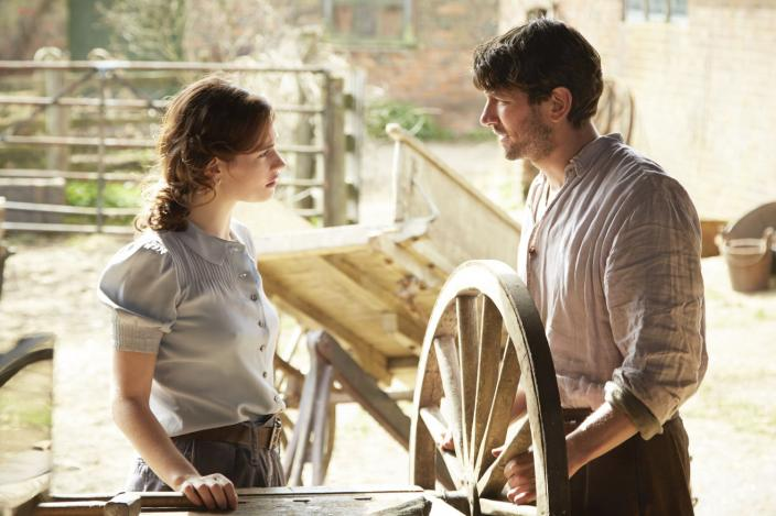 Juliet Ashton (Lily James) and Dawsey Adams (Michiel Huisman) finally meet face-to-face after forming an attachment by correspondence.  Photo courtesy of Studiocanal ©2017.
