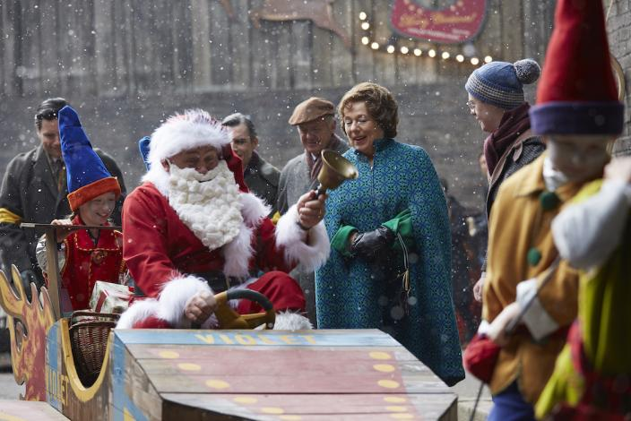 Fred Buckle (CLIFF PARISI) drives his rocket sleigh through Poplar as his wife Violet (ANNABELLE APSION) looks on (Photo Credit: Courtesy of Neal Street Production/BBC)