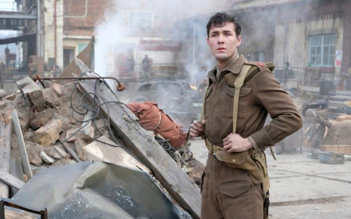 Jonah Hauer-King (as Harry Chase) in the ruins of Dunkirk. Credit: Courtesy of Ben Blackall / © Mammoth Screen 2019