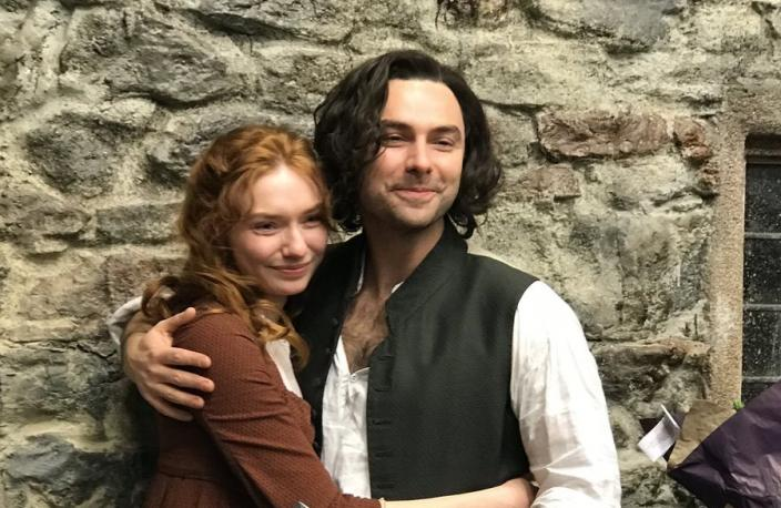 Aidan Turner and Eleanor Tomlinson celebrate the end of an era. (Image via BBC)