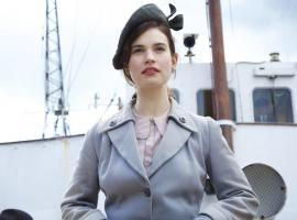 Downton Abbey's Lily James stars as Juliet Ashton in 'The Guernsey Literary and Potato Peel Pie Society'. (Photo courtesy of Studiocanal ©2017)