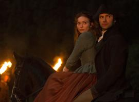 Ross and Demelza and dramatic firelight from the local riot. (Photo: Courtesy of Mammoth Screen for BBC and MASTERPIECE)