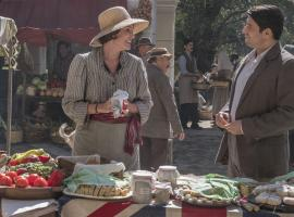 Friendly banter at the market between Louisa (Keeley Hawes) and Spiros (Alexis Georgoulis)  Photo: (Courtesy of John Rogers/Sid Gentle Films for ITV and MASTERPIECE)