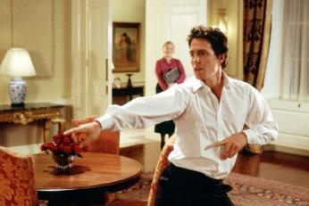 "Hugh Grant as everyone's favorite fictional Prime Minister in ""Love Actually"". (Photo: Universal Pictures)"