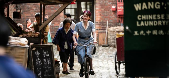 Nurse Gilbert (Charlotte Ritchie) peddles to her next appointment  Photo: Courtesy of Neal Street Productions 2016)