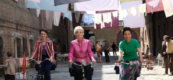 Nurses Franklin (Helen George), Anderson (Leonie Elliott) and Dyer (Jennifer Kirby) cycle through Poplar (Photo Credit: Courtesy of BBC/Neal Street Productions)