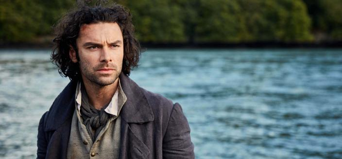 Aidan Turner, looking dreamy and rescuing folks. (Photo: Courtesy of Robert Viglasky/Mammoth Screen for BBC and MASTERPIECE)