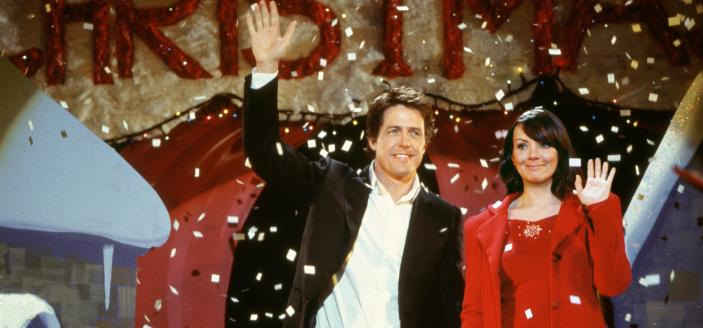 "Hugh Grant and Martine McCutcheon in ""Love Actually"". (Photo: Universal/Studio Canal)"