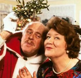 Richard (Clive Swift) and Hyacinth Bucket (Patricia Routledge) under the mistletoe. (Photo: Courtesy of BBC Worldwide)