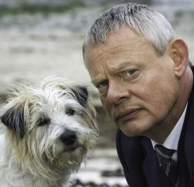"Martin Clunes and a very cute co-star in ""Doc Martin"". (Photo: American Public Television)"
