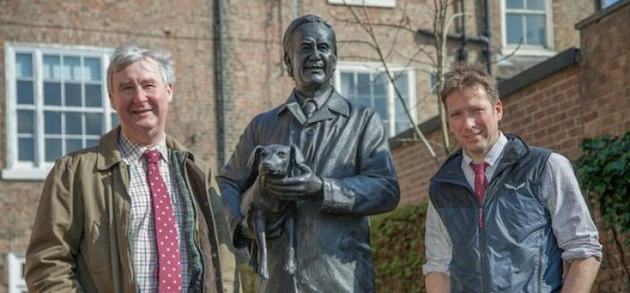Carrying on the tradition of all things great and small; veterinarians Peter Wright and Julian Norton with the statue of their mentor, James Herriot. © Daisybeck Studios/Channel 5