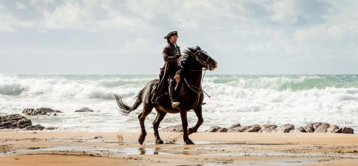 Ross, dramatically riding to save the day. Maybe. (Photo: Courtesy of Mammoth Screen for BBC and MASTERPIECE)