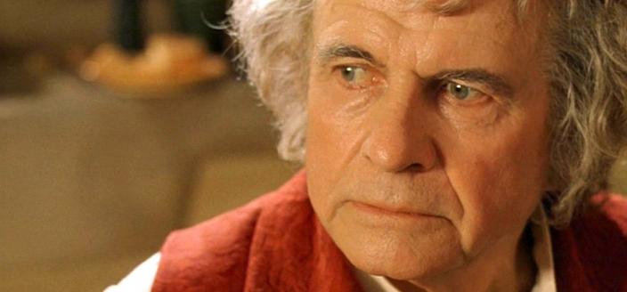 "Sir Ian Holm as Bilbo Baggins in ""The Lrod (Credit: New Line Cinema)"
