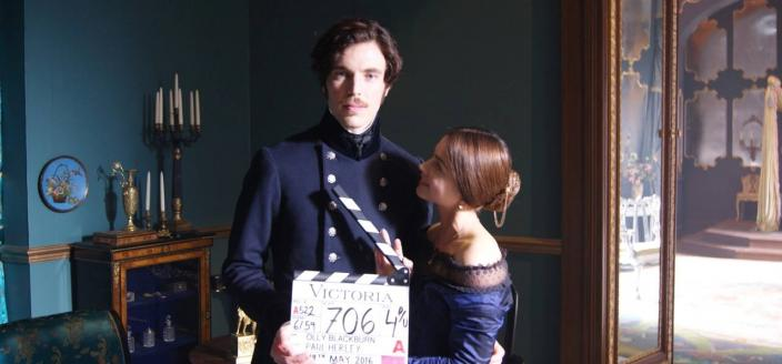 """Jenna Coleman and Tom Hughes on the set of """"Victoria"""". (Photo: ITV/Mammoth Screen)"""